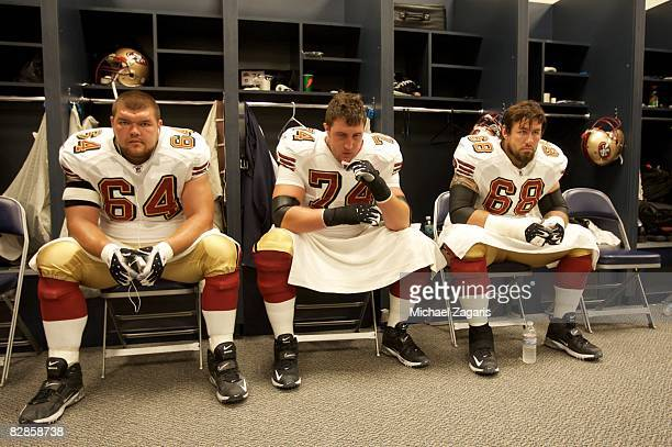 Guard David Baas offensive tackle Joe Staley and tackle Adam Snyder of the San Francisco 49ers look on in the locker room before an NFL game against...