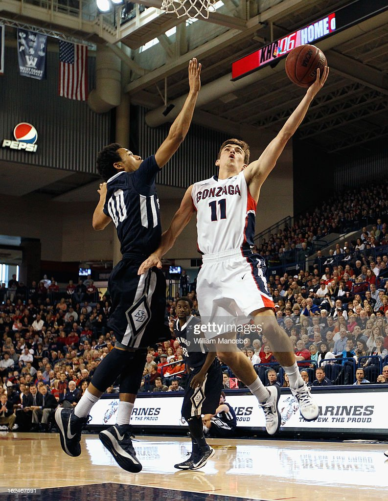 Guard David Stockton #11 of the Gonzaga Bulldogs attempts to score a goal against guard Christopher Anderson #00 of the San Diego Toreros during the first half of the game at McCarthey Athletic Center on February 23, 2013 in Spokane, Washington.