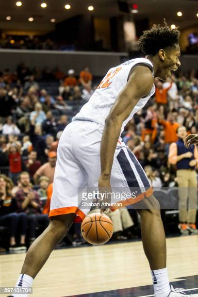 Guard De'Andre Hunter of the University of Virginia Cavalier reacts after dunking the ball against Hampton University at John Paul Jones Arena on...