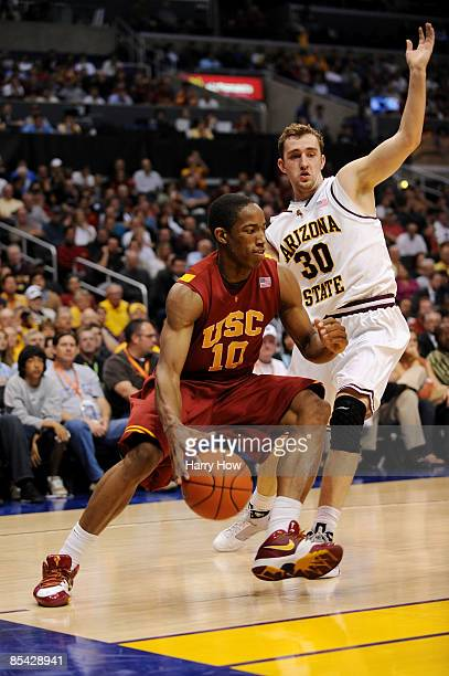 Guard DeMar DeRozan of the USC Trojans drives with the ball against the Arizona State Sun Devils in the Pacific Life Pac10 Men's Basketball...