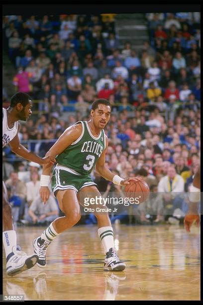 Guard Dennis Johnson of the Boston Celtics moves the ball during a game against the Golden State Warriors at the Coliseum Arena in Oakland California...