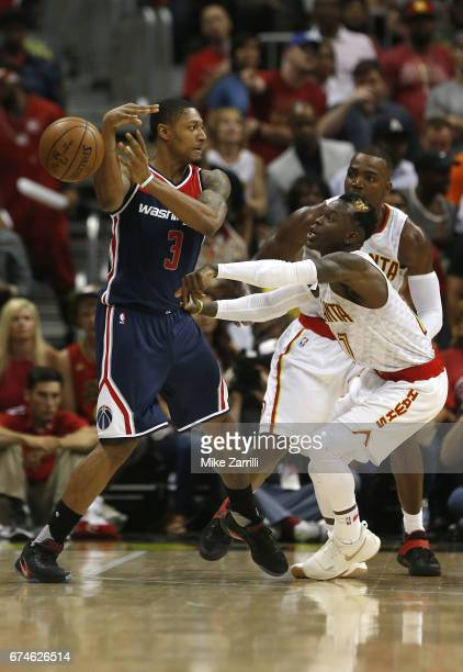Guard Dennis Schroder of the Atlanta Hawks knocks the ball away from guard Brandon Beal of the Washington Wizards during Game Six of the Eastern...