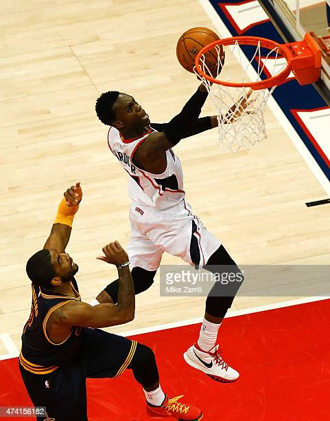 Guard Dennis Schroder of the Atlanta Hawks shoots over guard Kyrie Irving of the Cleveland Cavaliers during Game One of the Eastern Conference Finals...