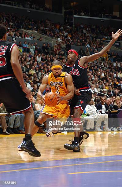 Guard Derek Fisher of the Los Angeles Lakers drives against the Chicago Bulls during the game at Staples Center on November 22 2002 in Los Angeles...