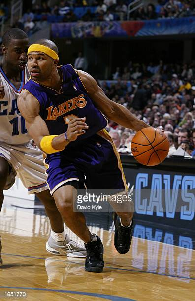 Guard Derek Fisher of the Los Angeles Lakers drives past guard Milt Palacio of the Cleveland Cavaliers during the game at Gund Arena on November 5...