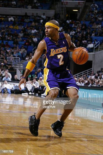 Guard Derek Fisher of the Los Angeles Lakers eyes the floor as he dribbles against the Cleveland Cavaliers during the game at Gund Arena on November...