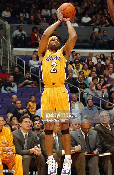 Guard Derek Fisher of the Los Angeles Lakers shoots a jump shot against the Chicago Bulls during the game at Staples Center on November 22 2002 in...