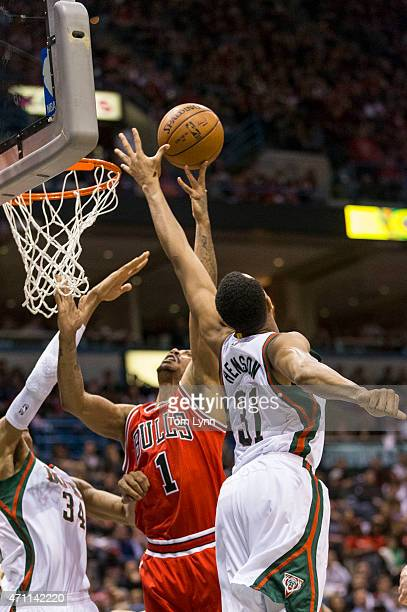 Guard Derrick Rose of the Chicago Bulls has his shot blocked by center John Henson of the Milwaukee Bucks in the second quarter of game four of the...