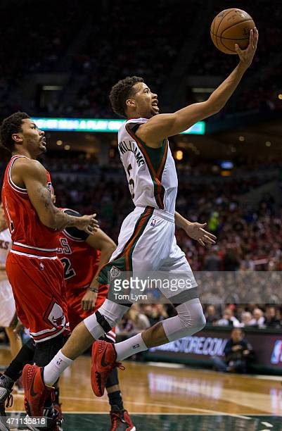 Guard Derrick Rose of the Chicago Bulls looks on as guard Michael CarterWilliams of the Milwaukee Bucks lays the ball up in the first quarter of game...
