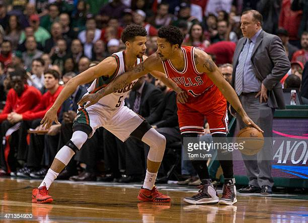 Guard Derrick Rose of the Chicago Bulls sets up a play as Michael CarterWilliams of the Milwaukee Bucks defends in the first quarter of game three of...