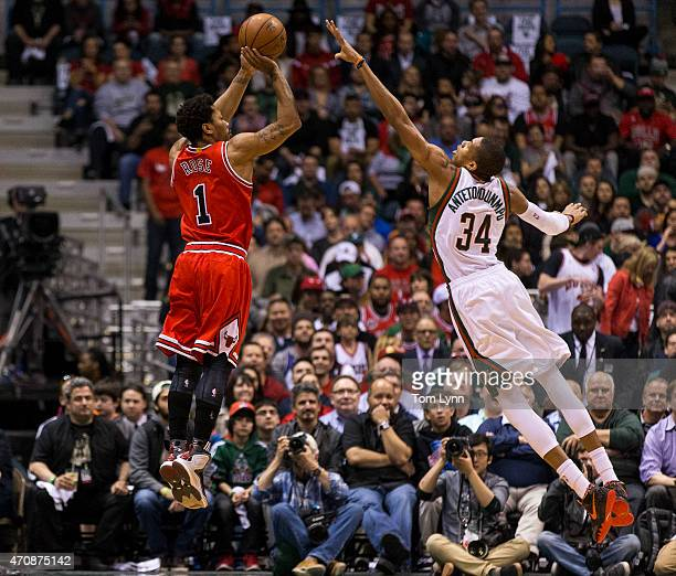 Guard Derrick Rose of the Chicago Bulls shoots over forward Giannis Antetokounmpo of the Milwaukee Bucks in the first quarter during during game...