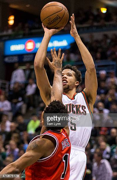 Guard Derrick Rose of the Chicago Bulls tries to block the shot of guard Michael CarterWilliams of the Milwaukee Bucks in the first quarter during...