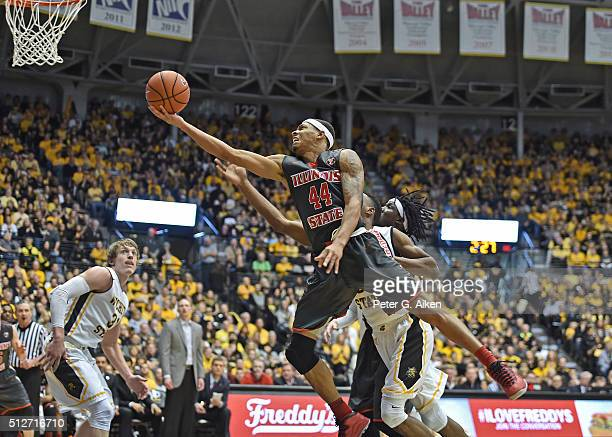 Guard DeVaughn AkoonPurcell of the Illinois State Redbirds drives in for a basket against the Wichita State Shockers during the second half on...