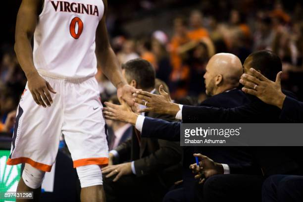Guard Devon Hall of the University of Virginia Cavalier shakes his coaches and teammates hands in a game against Hampton Univesity at John Paul Jones...