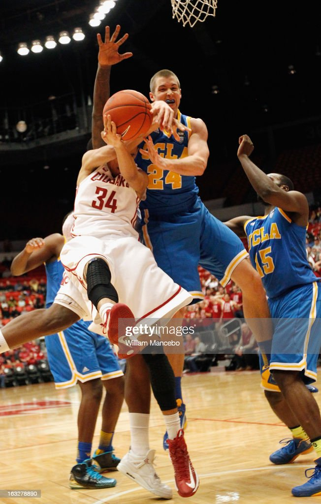 Guard Dexter Kernich-Drew #34 of the Washington State Cougars battles for a shot against forward Travis Wear #24 of the UCLA Bruins during the first half of the game at Beasley Coliseum on March 6, 2013 in Pullman, Washington.