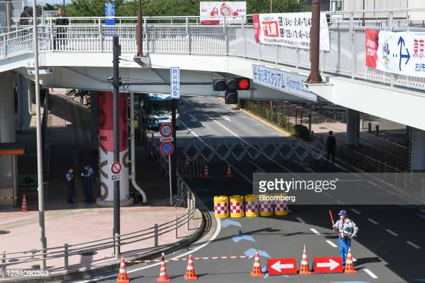 Guard directs traffic in front of Ajinomoto Stadium, ahead of an opening round women's football match between the U.S. And Sweden, at the Tokyo 2020...