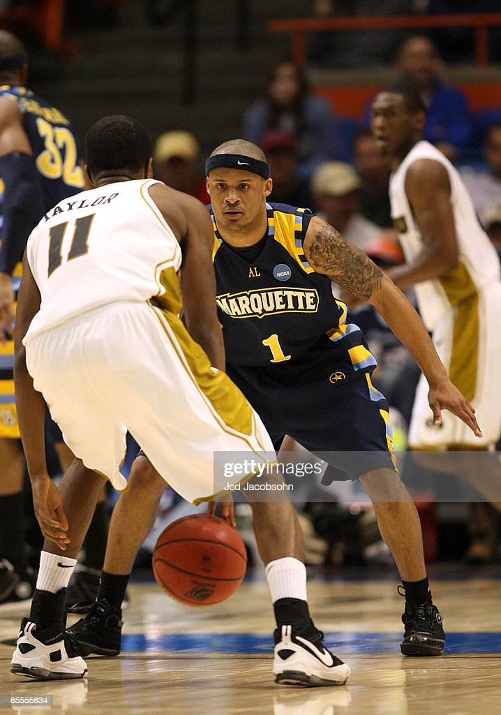Guard Dominic James #1 of the Marquette Golden Eagles defends guard Zaire Taylor #11 of the Missouri Tigers during the second round of the NCAA Division I Men's Basketball Tournament at the Taco Bell Arena on March 22, 2009 in Boise, Idaho.