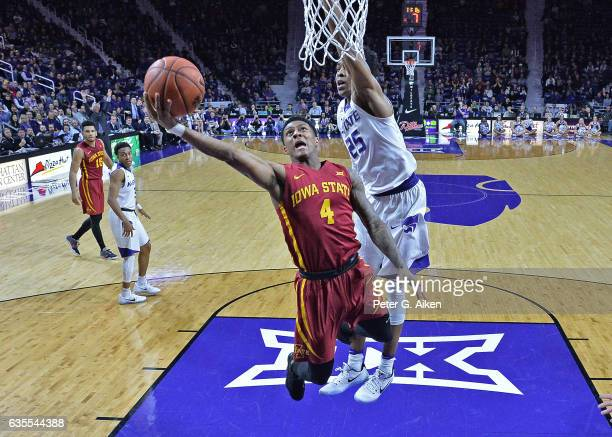 Guard Donovan Jackson of the Iowa State Cyclones drives to the basket against guard Wesley Iwundu of the Kansas State Wildcats during the second half...