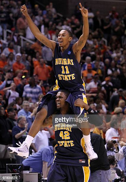 Guard Donte Poole and forward Ivan Aska of the Murray State Racers react after defeating the Vanderbilt Commodores 6665 in the first round of the...
