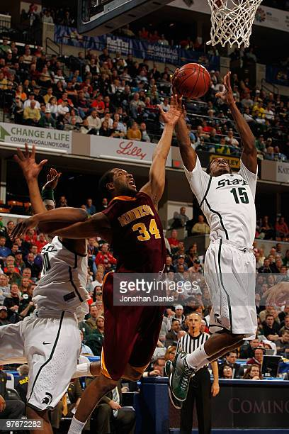 Guard Durrell Summers of the Michigan State Spartans grabs a rebound in front of forward Damian Johnson of the Minnesota Golden Gophers during the...