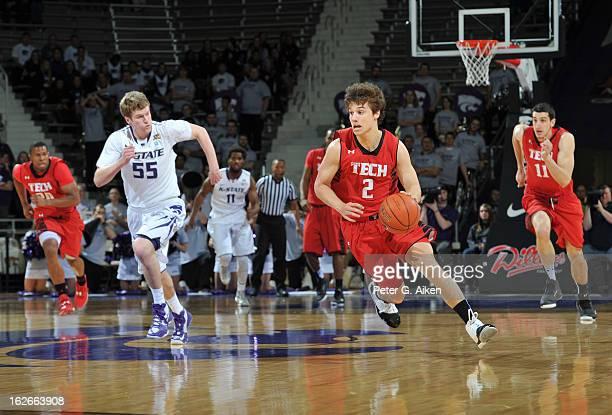Guard Dusty Hannahs of the Texas Tech Red Raiders heads up court after stealing the ball from guard Will Spradling of the Kansas State Wildcats...
