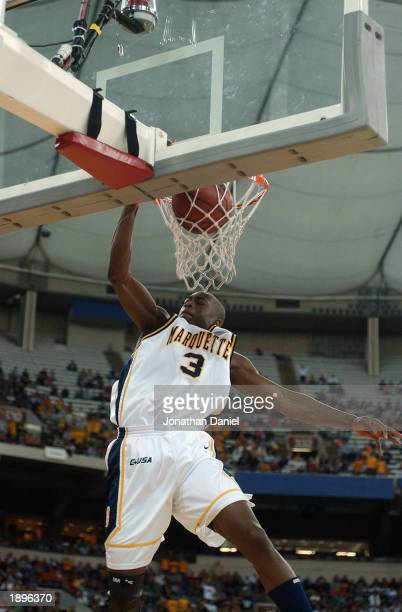 Guard Dwyane Wade of Marquette slams the ball during a game against Missouri in the 2nd round of the NCAA Tournament on March 22 2003 at the RCA Dome...