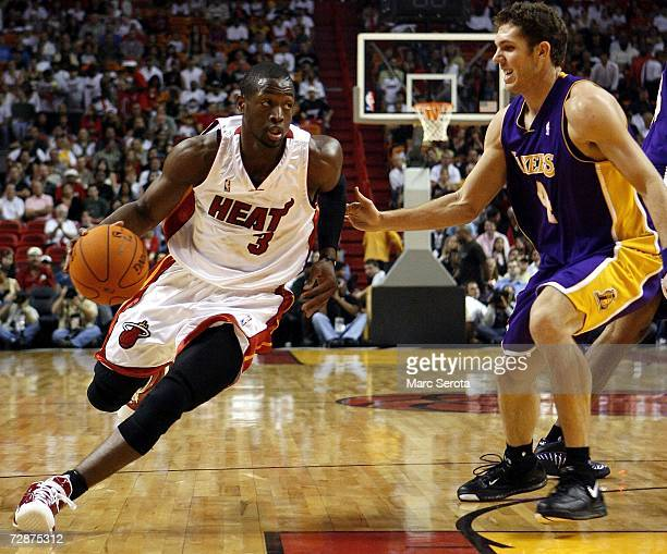 Guard Dwyane Wade of the Miami Heat drives against forward Luke Walton of the Los Angeles Lakers on December 25 2006 at the American Airlines Arena...