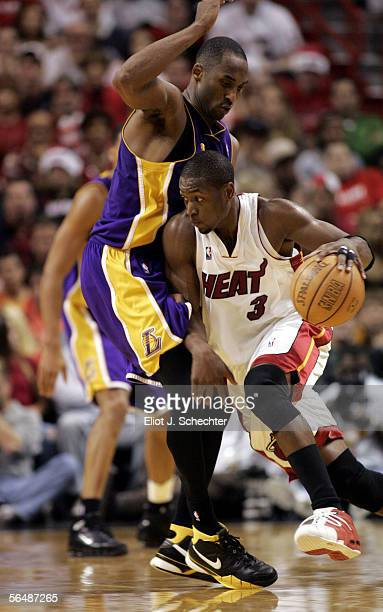 Guard Dwyane Wade of the Miami Heat drives against guard Kobe Bryant of the Los Angeles Lakers on December 25 2005 at the American Airlines Arena in...