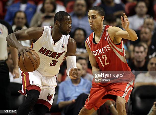 Guard Dwyane Wade of the Miami Heat drives against gurad Kevin Martin of the Houston Rockets at American Airlines Arena on March 27 2011 in Miami...