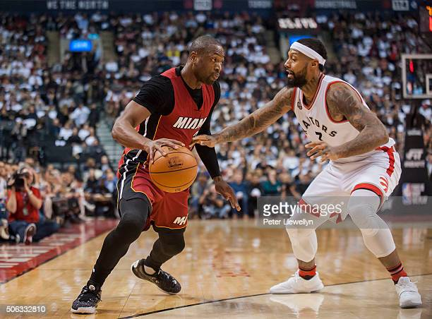 Guard Dwyane Wade of the Miami Heat handles the ball against forward James Johnson of the Toronto Raptors in the first quarter at Air Canada Centre...