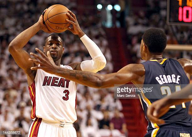 Guard Dwyane Wade of the Miami Heat looks to pass against Guard Paul George of the Indiana Pacers in Game One of the Eastern Conference Semifinals in...