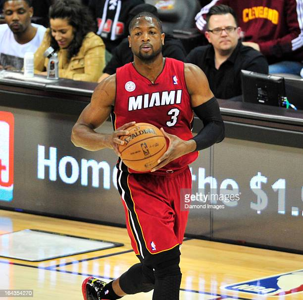 Guard Dwyane Wade of the Miami Heat looks to pass the basketball during a game against the Cleveland Cavaliers at Quicken Loans Arena in Cleveland...