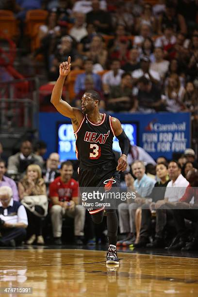 Guard Dwyane Wade of the Miami Heat plays against the Chicago Bulls at AmericanAirlines Arena on February 23 2014 in Miami FloridaThe Heat defeated...
