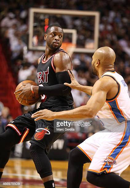 Guard Dwyane Wade of the Miami Heat plays against the Oklahoma City Thunder at AmericanAirlines Arena on January 29 2014 in Miami Florida The Thunder...