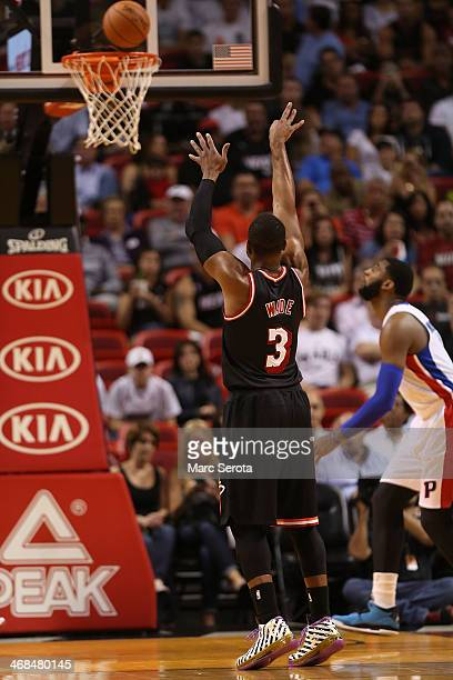 Guard Dwyane Wade of the Miami Heat plays during a game against the Detroit Pistons at AmericanAirlines Arena on February 3 2014 in Miami Florida...