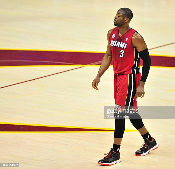 Guard Dwyane Wade of the Miami Heat walks onto the court after a timeout during a game against the Cleveland Cavaliers at Quicken Loans Arena in...