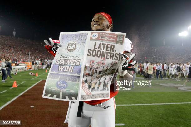 Guard Dyshon Sims of the Georgia Bulldogs celebrates after defeating the Oklahoma Sooners 5448 in double overtime in the 2018 College Football...