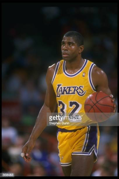 Guard Earvin Johnson of the Los Angeles Lakers looks on during a game