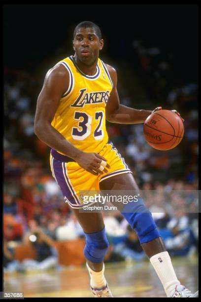 Guard Earvin Johnson of the Los Angeles Lakers moves the ball during a game against the Portland Trail Blazers at the Rose Garden in Portland Oregon