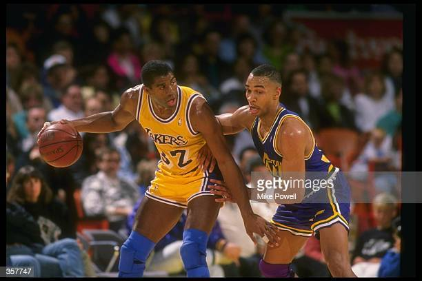 Guard Earvin Johnson of the Los Angeles Lakers moves the ball during a game