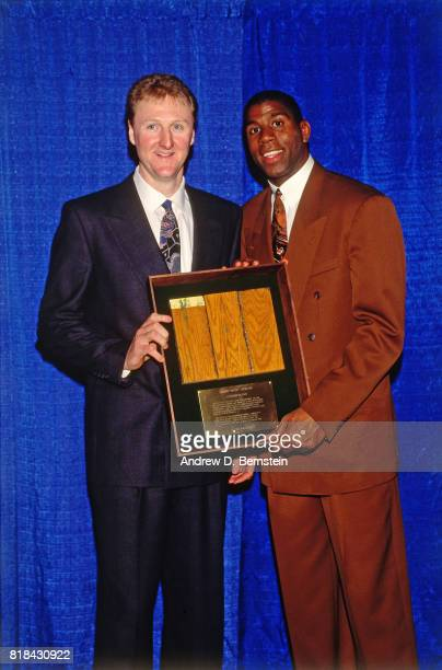 1992 Guard Earvin Johnson of the Los Angeles Lakers poses for a picture with Larry Bird at his retirement ceremony at the Great Western Forum in...