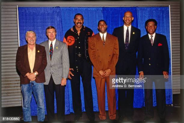 1992 Guard Earvin Johnson of the Los Angeles Lakers poses with Kareem AbdulJabbar at his retirement ceremony at the Great Western Forum in Inglewood...