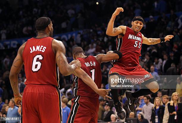 Guard Eddie House of the Miami Heat celebrates with Chris Bosh and LeBron James after a 108103 win against the Oklahoma City Thunder at Ford Center...