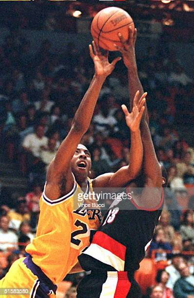 Guard Eddie Jones of the Los Angeles Lakers has his shot blocked by Aaron McKie of the Portland Trail Blazers during their 22 April game in Los...