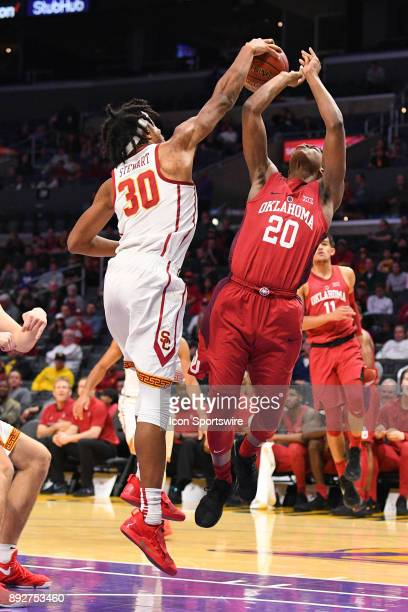 USC guard Elijah Stewart blocks Oklahoma guard Kameron McGusty shot during an college basketball game between the Oklahoma Sooners and the USC...