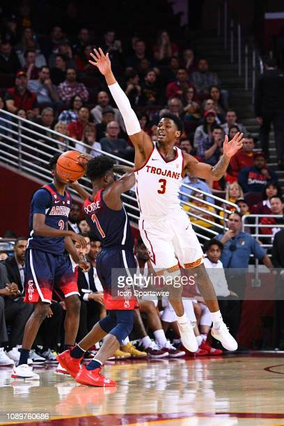 USC guard Elijah Weaver defends Arizona guard Devonaire Doutrive during a college basketball game between the Arizona Wildcats and the USC Trojans on...