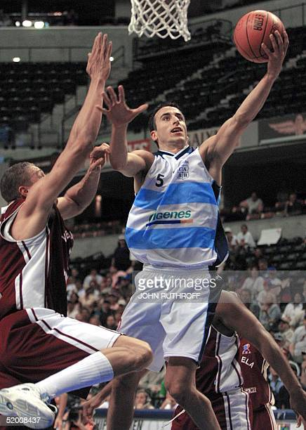 Guard Emanuel Manu Ginobili Argentina goes to the hoop as center Richard Lugo of Venezuela defendes during the first day of the 2002 FIBA World...