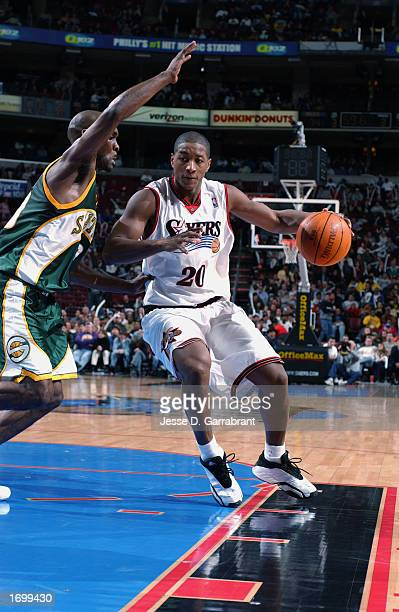 Guard Eric Snow of the Philadelphia 76ers drives against guard Gary Payton of the Seattle Sonics during the game at First Union Center on December 11...