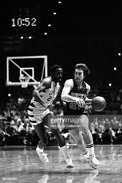 Guard Ernie Grunfeld of the Milwaukee Bucks tries to drive towards the basket around Campy Russell of the Cleveland Cavaliers during a game on...