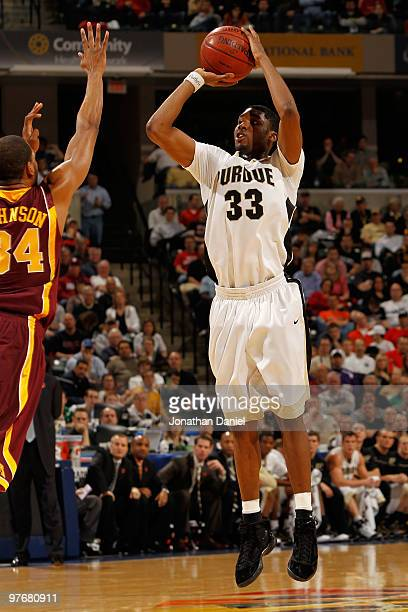 Guard E'Twaun Moore of the Purdue Boilermakers takes a shot against forward Damian Johnson of the Minnesota Golden Gophers in the semifinals of the...